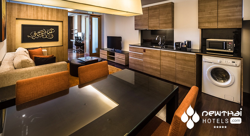 Living and dining room in three bedroom suite at akyra Thonglor Bangkok