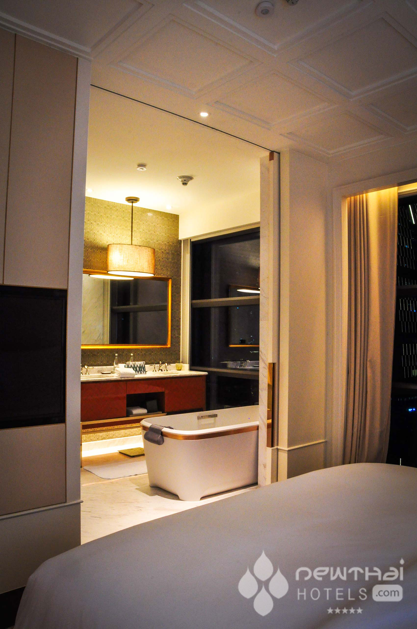 View of the bathroom from the bedroom at Rosewood Bangkok