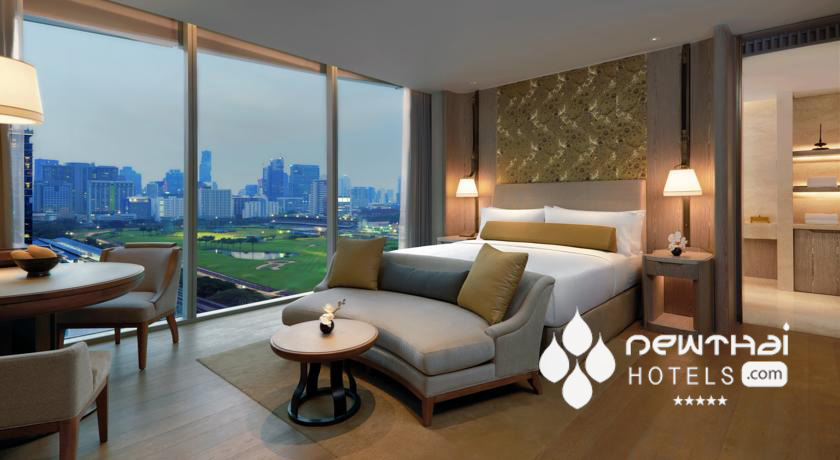 Guest room with view of the Royal Bangkok Sports Club at The Waldorf Astoria Bangkok